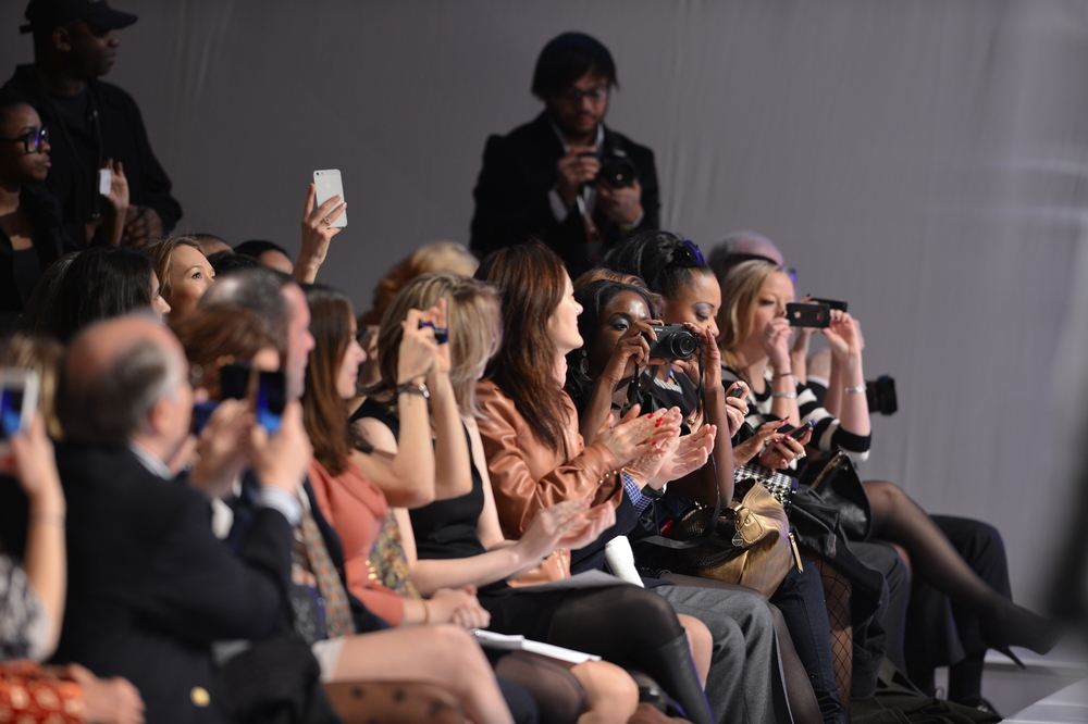 NEW YORK - FEBRUARY 15: People in front raw at the runway during Catalin Botezatu fashion show at The New Yorker Hotel during Couture Fashion Week on February 15, 2013 in New York City
