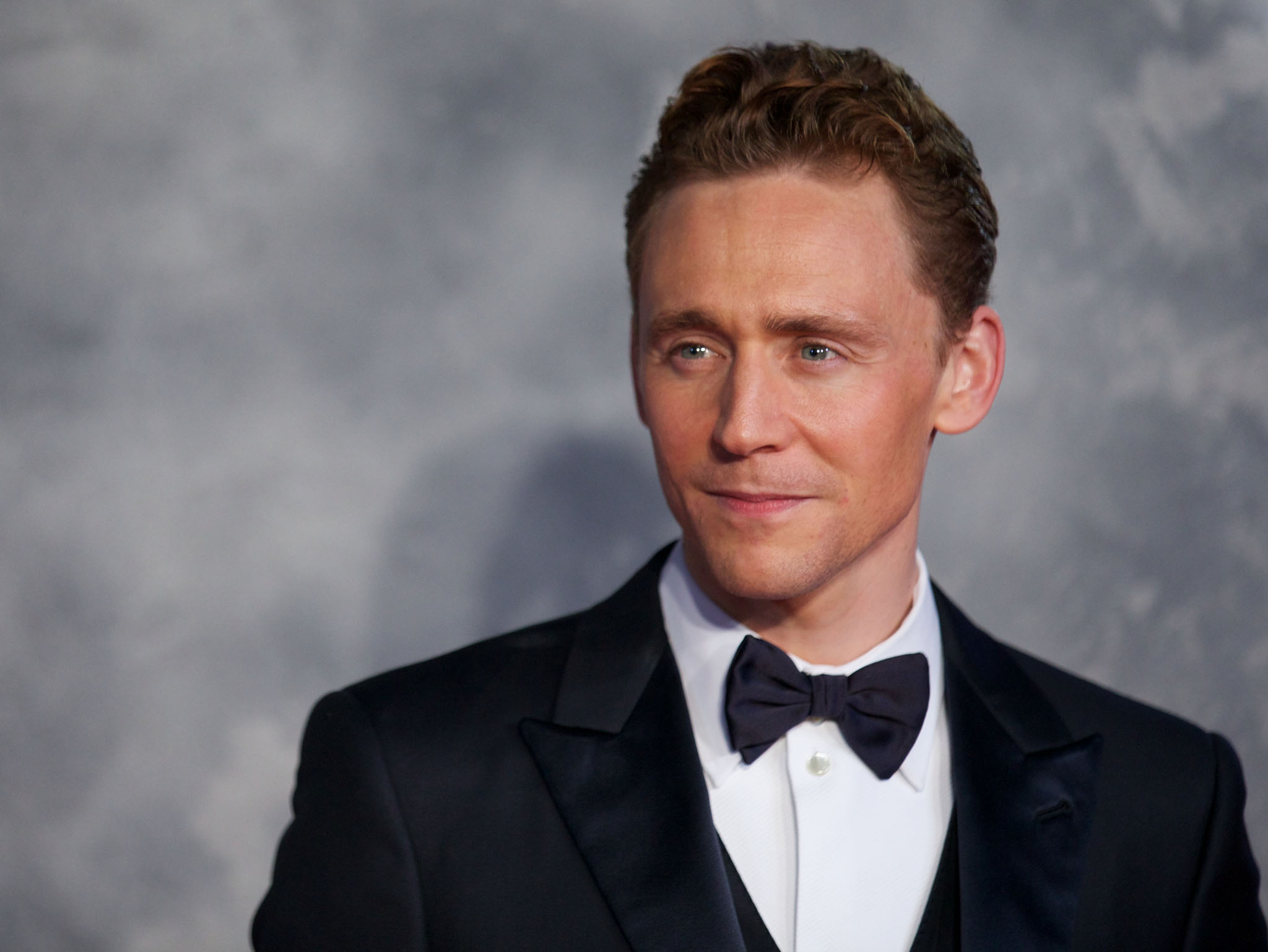 British actor Tom Hiddleston attends the world film premiere of 'Thor, The Dark World' in central London on October 22, 2013. AFP PHOTO/ANDREW COWIE        (Photo credit should read ANDREW COWIE/AFP/Getty Images)